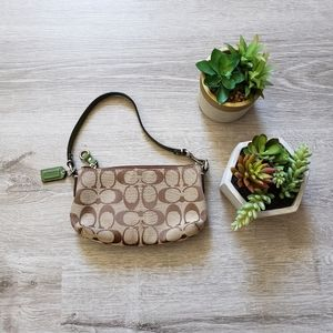 COACH monogrammed green leather mini clutch